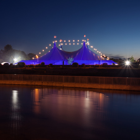 big top:  Big Top  circus style blue tent and Galway Cathedral on the bank of Corrib river in Galway, Ireland