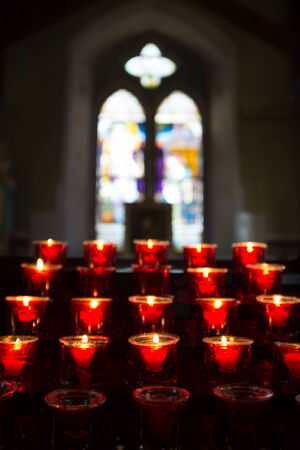 memorial candle: Row of burning candles in the church. Shallow DOF