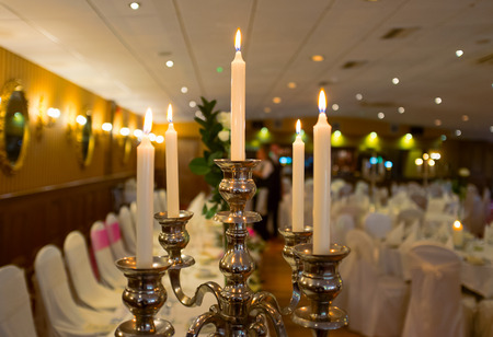 candle light dinner: Candles and Wedding dinner set up in the luxury restaurant. Shallow DOF