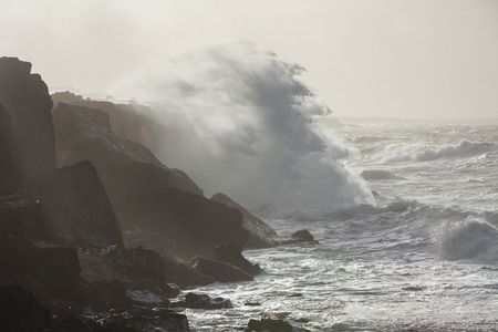 breaking wave: Big waves breaking on cliffs during winter storm on the west coast of Ireland. Stock Photo
