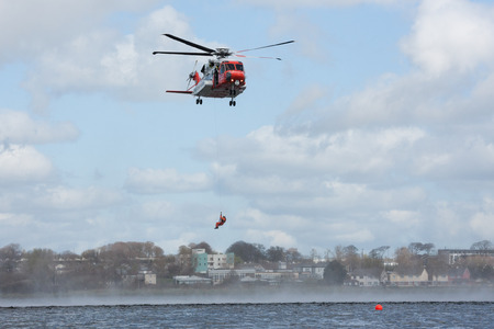 lough: GALWAY, IRELAND - APRIL 12: Irish Coast Guard crew display a water rescue training over Lough Atalia as part of the anual Galway Watersports Show, on April 12, 2015 in Galway, Ireland. Editorial