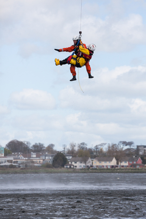 watersports: GALWAY, IRELAND - APRIL 12: Irish Coast Guard crew display a water rescue training over Lough Atalia as part of the anual Galway Watersports Show, on April 12, 2015 in Galway, Ireland. Editorial