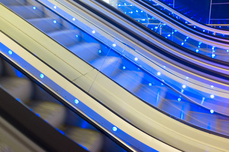 elevated walkway: Moving Escalator with blue lights. Detail. Abstract background.
