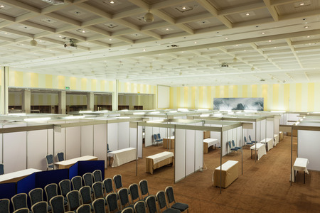 exhibitions: Trade show interior with booth and tables