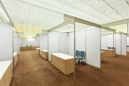 trade show: Trade show interior with booth and tables
