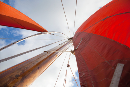 vickers: Traditional Wooden Boat, with red sail. Detail. Abstract