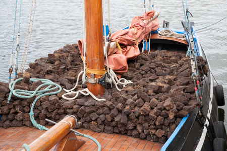 hooker: Traditional wooden boat Galway Hooker, loaded with turf. Stock Photo