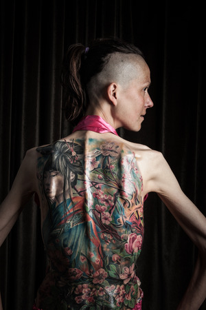 12 13: GALWAY, IRELAND - SEPTEMBER 12: Portrait of unidentified  woman with tattoo who was taking part at The 3rd Annual International Galway Tattoo Show , on September 13, 2015 in Galway, Ireland.
