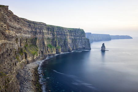 sea cliff: View at the Cliffs of Moher during the sunset. Stock Photo