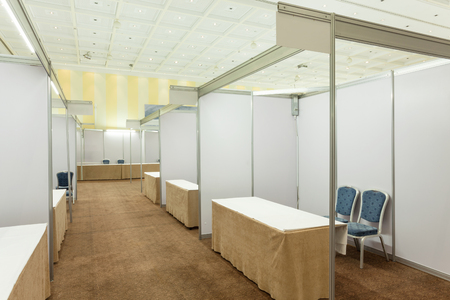 trades: Trade show interior with booth and tables