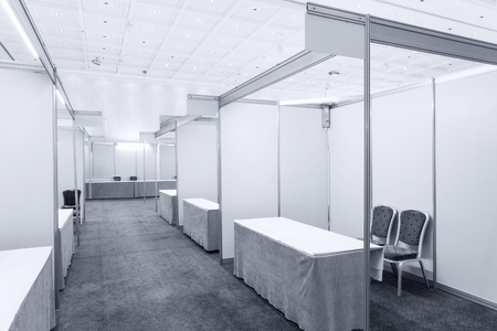 trade fair: Trade show interior with booth and tables