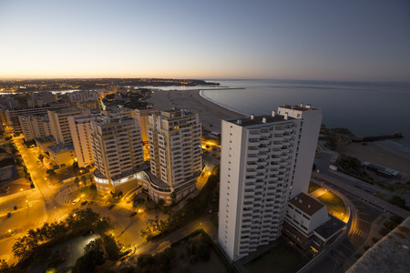 rocha: Hotels and beach at the bank of the ocean during sunrise. Vew from above. Pria Da Rocha, Portimao, Portugal. Stock Photo
