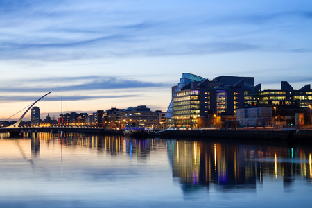 liffey: Dublin City Center during sunset with Samuel Beckett Bridge and river Liffey Stock Photo