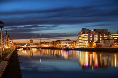 liffey: Dublin City Center during sunset with Samuel Beckett Bridge and river Liffey Stock Photo