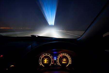 speeding: Driver view at speeding car  dashboard and motorway  at night