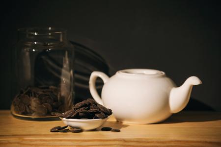 white ceramic teapot and chocolate Фото со стока