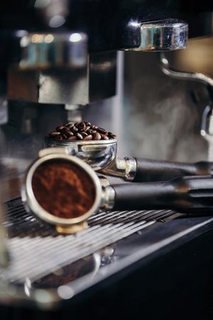 Barista roasting coffee beans grinder on coffee espresso machine Фото со стока
