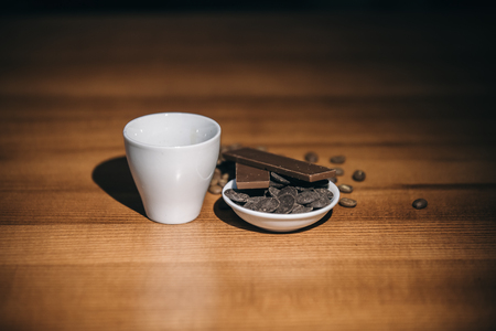 cup of hot coffee and chocolate on a wooden table Фото со стока