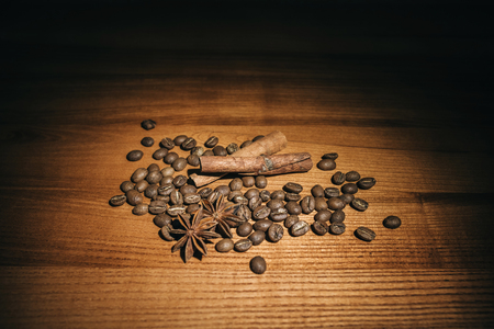 Brown background with anise, cinnamon and coffee beans. Фото со стока
