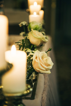Candles and a white rose