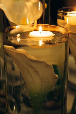 Vases with candles and lilies