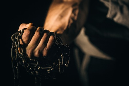 Fist hand holds the chain. Concept fitness, lifting, fitness. Фото со стока