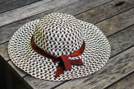 Woven hat on wood table. photo