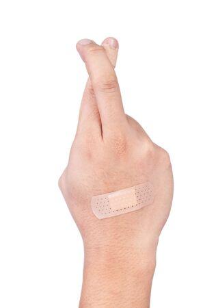 cross finger on white background Stock Photo