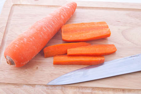 carrots on a cutting board with knife
