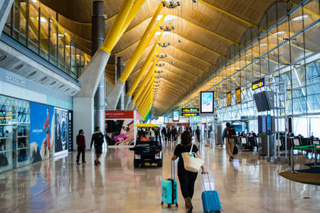 Woman with bag walking at Madrid airport to take her fly
