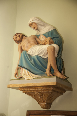 mournful: Virgin Mary holding Jesus Christ