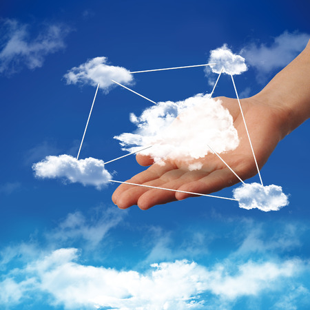 cloud computing with a cloud in a blue sky Stock Photo
