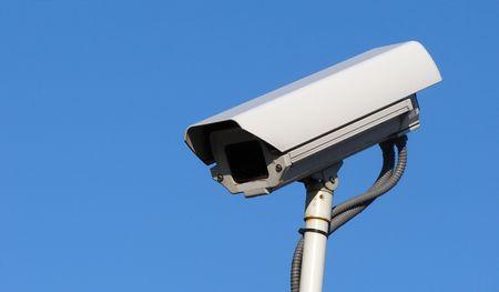 closed circuit:                                Surveillance camera against a blue sky Stock Photo