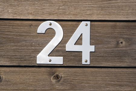 numerical: number 24 on a wooden fence Stock Photo