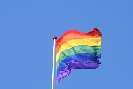 Rainbow flag with blue sky