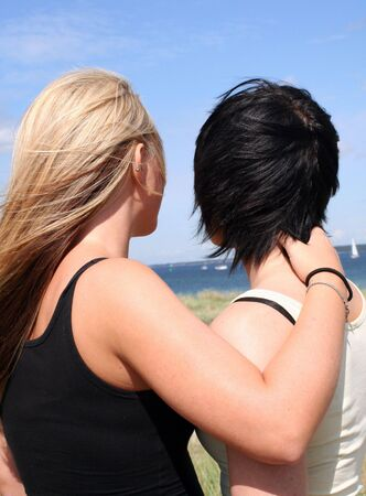 lesbianism: Two girls flirting in the sun Stock Photo