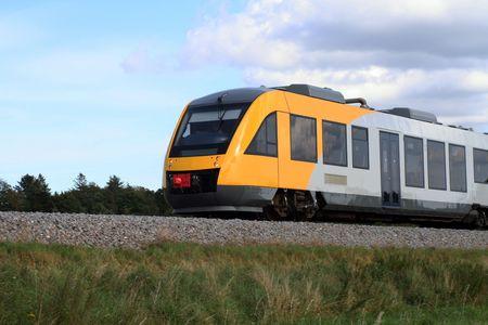 little yellow train in motion