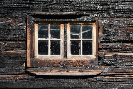 window in a burned wooden house photo