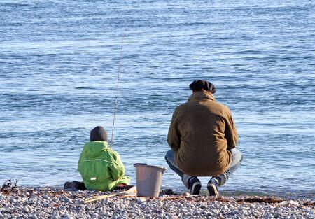 granddad: granpa and granson fishing Stock Photo