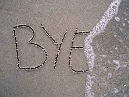 goodbye: Bye bye written in the sand at the beach