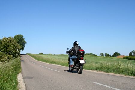 biker driving away photo