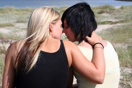 Two women kissing in the sun photo