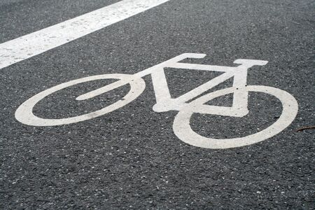 lane: white painted sign on the asphalt for bike path