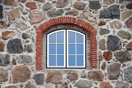 exterior walls: window in a stone built house Stock Photo