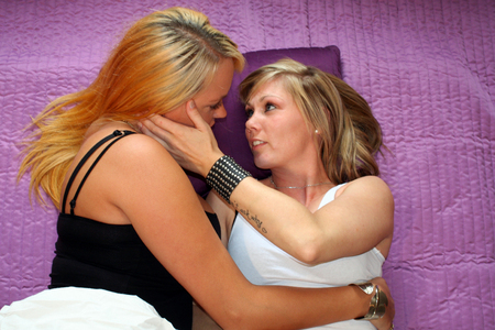 lesbianism: two young women in bed Stock Photo