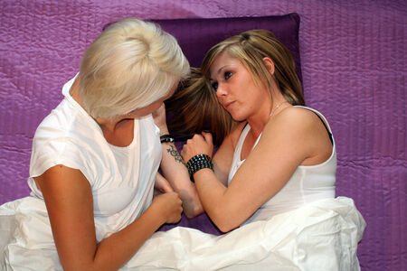 lesbianism: two young women in bed flirting