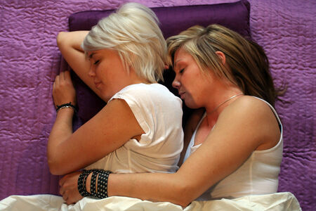 two young women in bed sleeping photo
