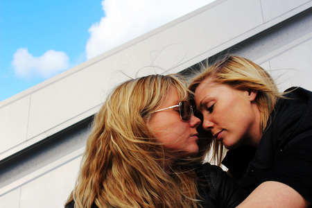 Two woman flirting in the sunshine photo