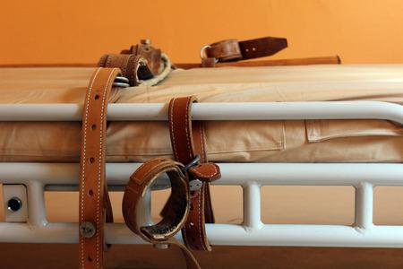 psychiatric: bed for restraining Stock Photo
