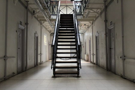 detention: the hallway in a prison cell block